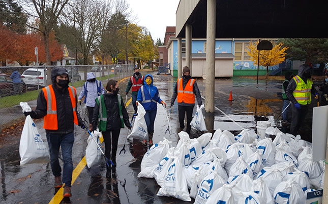Photo of volunteers and the litter they picked up around St. Johns on Saturday, Nov. 14