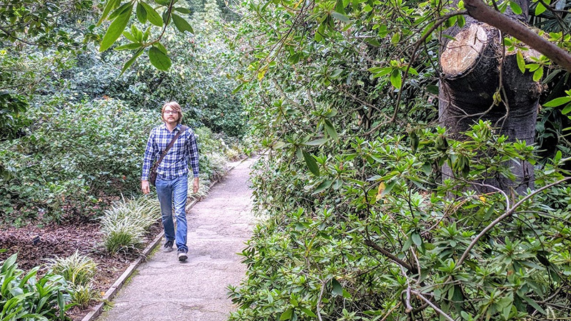 Picture of Elliot Frantz walking in park. He created website to find a date.